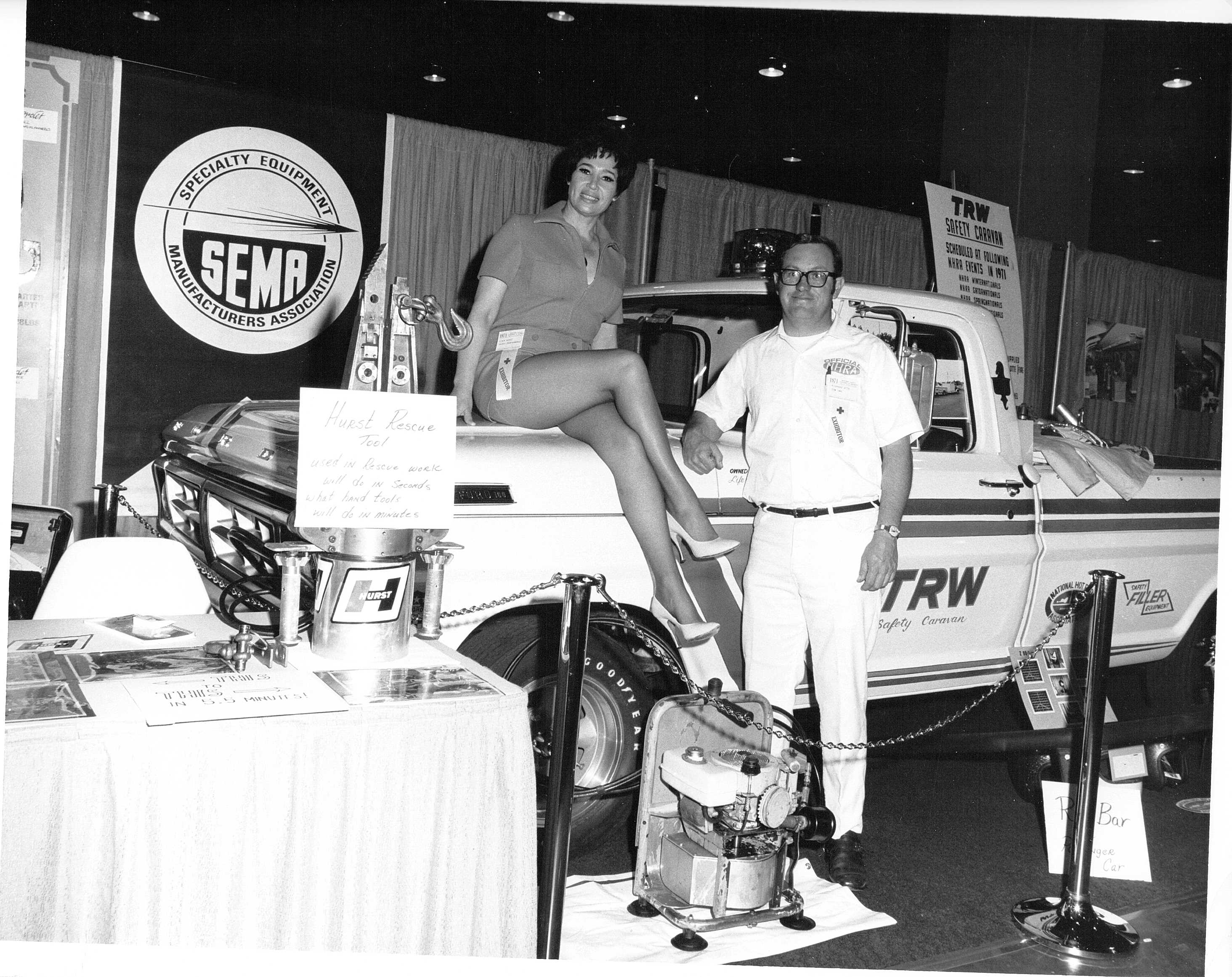 The first public introduction of the Jaws of Life (then called the Hurst Power Tool) at the 1971 SEMA trade show in California. Pictured here is Dick Otte (with possible George Hurst's wife?) The booth featured the TRW Caravan.