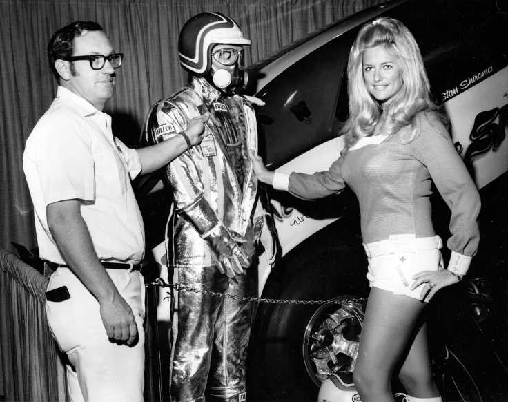 Dick Otte and Hurst Shifter Girl Linda Vaughn at the 1971 SEMA show in California. Along with the TRW Safety Caravan & the Jaws of LIfe, the booth featured specialized driving suits developed by Filler Safety Products (and an NHRA Funny Car too).