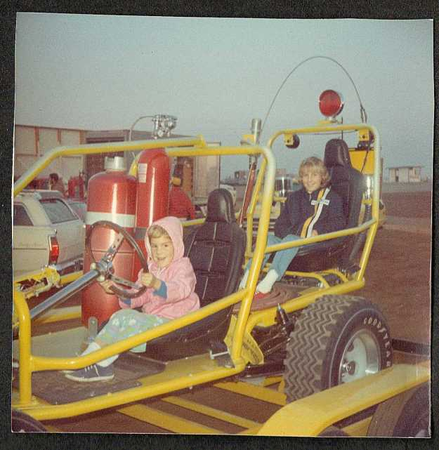 My sister Cindy (in back) and me in one of the fire-fighting Dune Buggies after a race at Riverside Raceway circa 1969