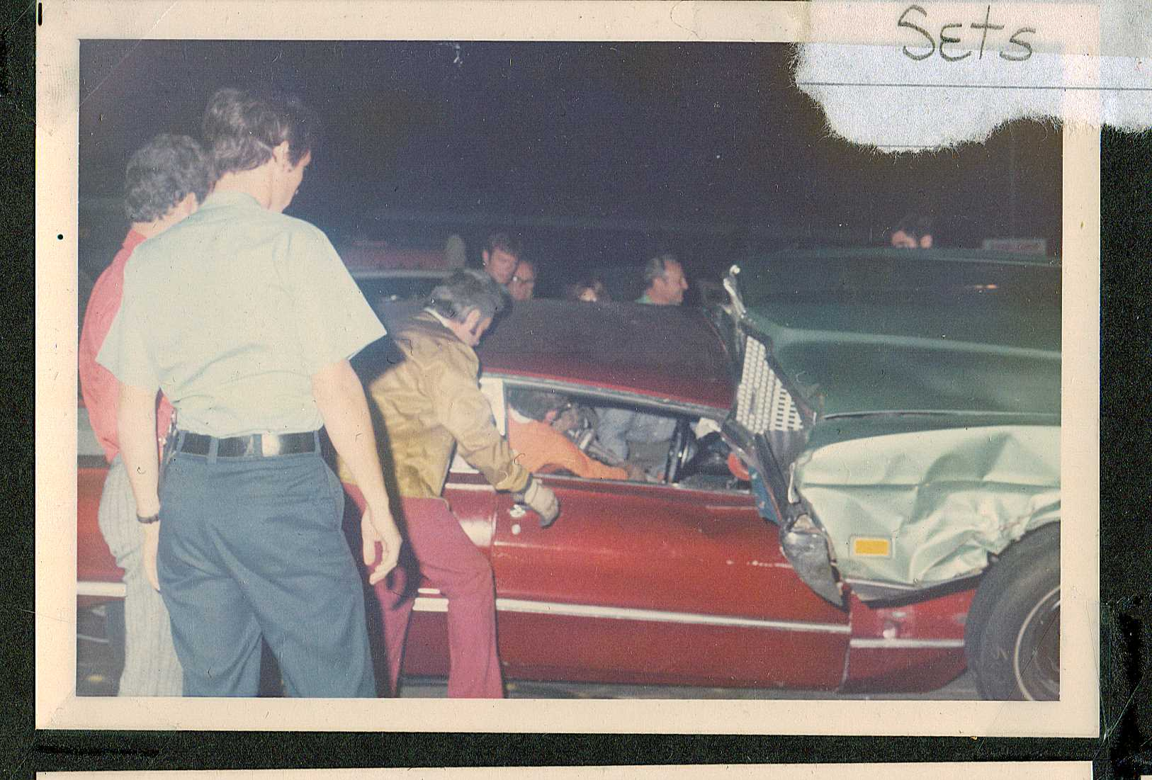 "On the set of Emergency (June 1972), Dick Otte inside the ""crashed"" car setting up for filming"