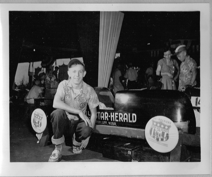 Dick Otte with his car in Akron for the All American Soap Box Derby, August 1951. His Akron sponsor was the Scottsbluff Daily Star-Herald.