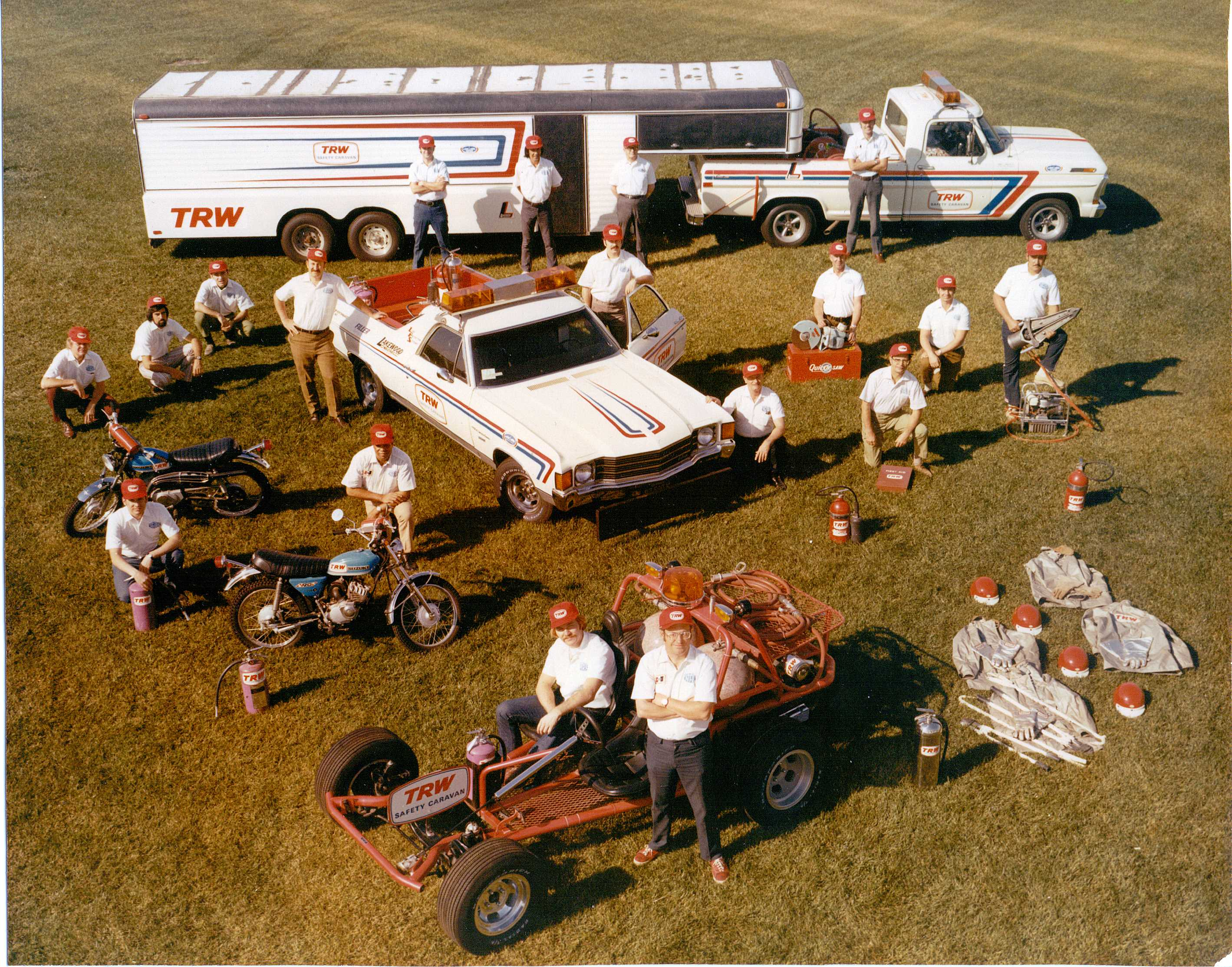 "Dick Otte (front & center with red sneakers) with his TRW Safety Caravan Crew. Notice the Hurst ""Jaws of Life"" prominently featured (mid-right side)- c.1972"